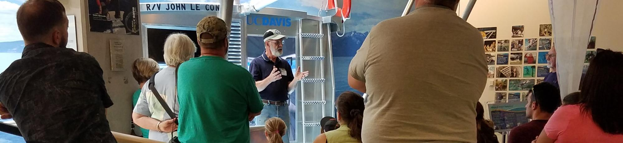 Docent Jim discusses Tahoe with visitors